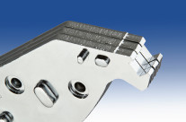 Product photograph from a metal stamping plant. Brake shoe pads use on commercial airline jets.