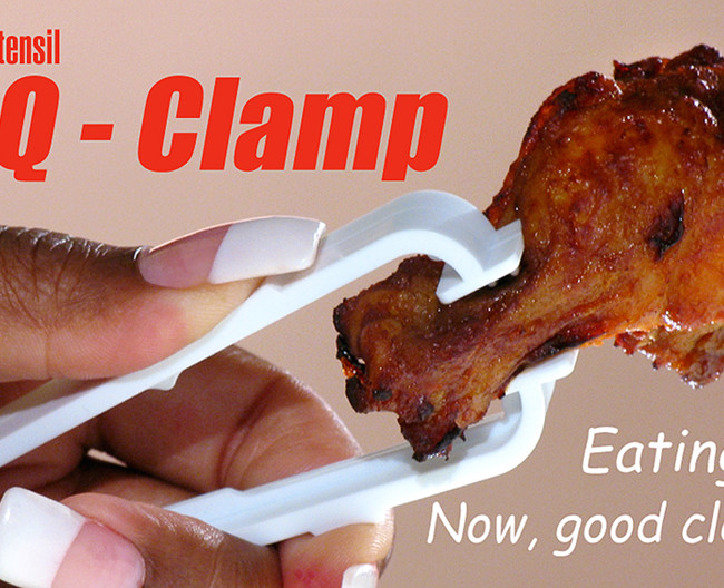 Product image of a plastic tong, sold to keep fingers and nails clean when dealing with chicken wings.