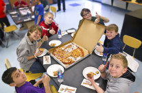 Event at school, student wins essay contest and receives a pizza party for classmates