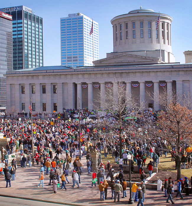 Protesters gather in the morning on the front lawn of the Ohio State House.