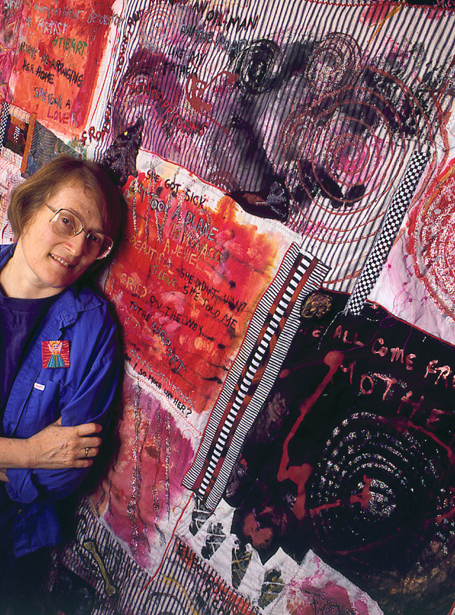 People a tapestry artist with her work