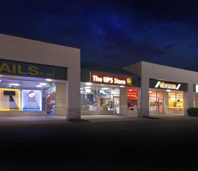 Evening image used to promote an investment offer for shareholders, of a small mall.