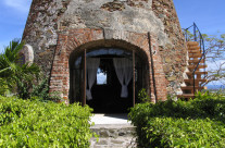 Island of St.Thomas, front entrance to a 1620 sugar cane windmill converted to a residence.