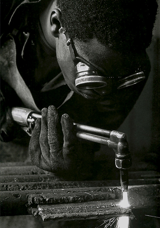 Metal worker, taken as part of a series for a brochure on behalf of The Ohio Department of Corrections