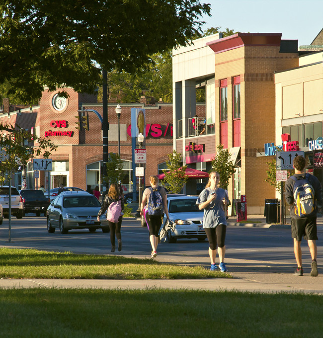 Life style view of OSU campus retail shopping along N. High St. The image was used in an update brochure for Ohio Stater Student housing marketing.