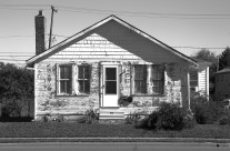 Came across this house while out on an assignment. The peeling paint, a bright sunny day and the total textural appearance lent towards an interesting black and white treatment.