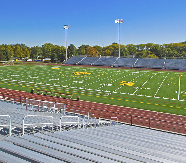 New artificial turf with school mascot embedded, showcases the football field at Upper Arlington high school.