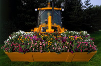 This front loader full of flowers was created as promotional piece to support a company's efforts in non-destructive landscaping.