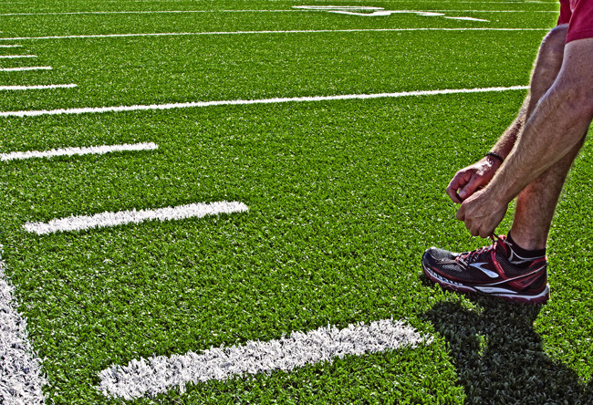 Documentation of a new artificial turf product applied to a high school football field, for use in an architectural firm's marketing.