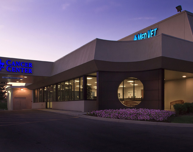 An early sunrise view of a 24 hour pet emergency center. Image used for an investment proposal.