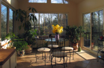 An image of a sun room addition with a conservatory flare used in marking.