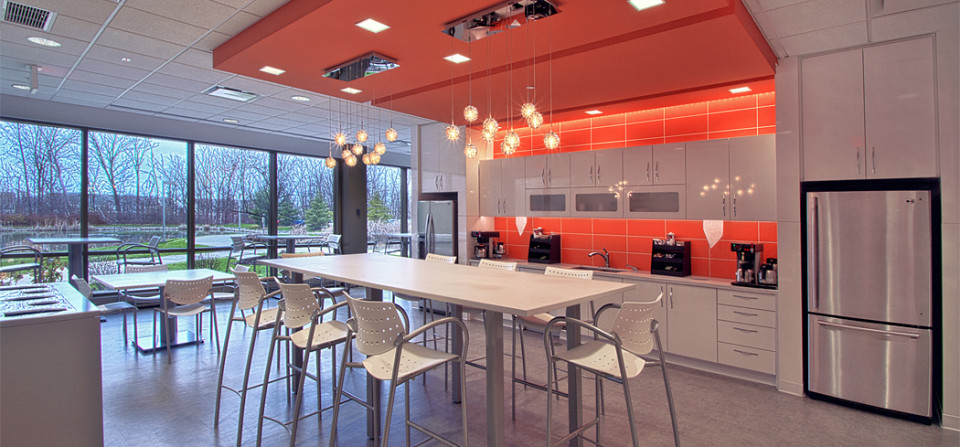 This image documents the new offices of an architectural firm. Shown here is the on site kitchen and lunch seating area.