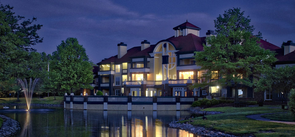 The late evening adds a touch of elegance, to an older apartment community's clubhouse.