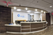This front desk readapts the interior of a decades old office building for the Central Ohio Urology Group.